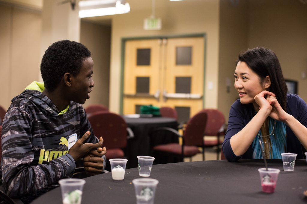 A Renton student talking with a Starbucks employee.